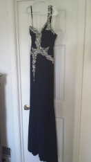 $100 + shipping. Black one-shoulder gown with slit and crystal/ AB stones. Size 4 (fits like a 2). Jersey material. Worn once for appearance.